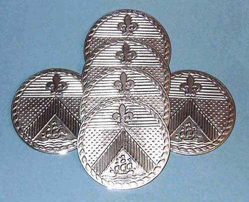 A set of cast pewter coasters